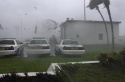 The roof of a garage is blown off onto Charlotte County Sheriff\'s cruisers from winds of Hurricane Charley in the parking lot of the Charlotte County Airport, Friday, Aug. 13, 2004, in Punta Gorda,Fla. (AP Photo/Scott Martin)