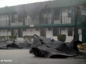 Fri., Aug. 13: A building has part of its roof torn off along Estero Blvd. by Hurricane Charley on Fort Myers Beach, Fla.