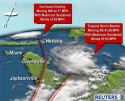 Hurricane Charley battered the tiny Cayman Islands and spurred evacuations in Cuba on August 12, 2004 while Tropical Storm Bonnie threatened coastal flooding as it raced for the soggy Florida Panhandle. Charley powered up overnight and carried 85 mph winds as it swept past Jamaica and over the Caymans toward Cuba,