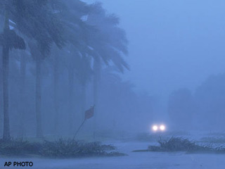 Fri., Aug. 13: High winds and heavy rains from Hurricane Charley reduced visibility severely and scattered trees across roadways in downtown Naples, Fla