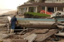 John Lumberson stands by a washed out swimming pool and views the damage done by Hurricane Jeanne early Sunday, Sept. 26, 2004, in Hutchinson Island, Fla. Lumberson is in charge of repairs at the resort. (AP Photo/J. Pat Carter)