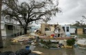 A destroyed mobile home sits in the flooded Port St. Lucie Mobile Village in Port St. Lucie, Florida in the aftermath of Hurricane Jeanne, September 26, 2004. REUTERS/Joe Skipper