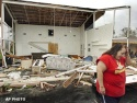 Sun., Sept. 26: Pennwood Moter Lodge maid Robin Bailey walks away from what was the lodge\'s front office on U.S. Highway 1 near Sebastian, Fla. Hurricane Jeanne blew off the roof Saturday night.