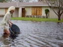Sun., Sept. 26: Penny Scheltz clears out storm drains during flooding, in North Palm Beach, Fla.